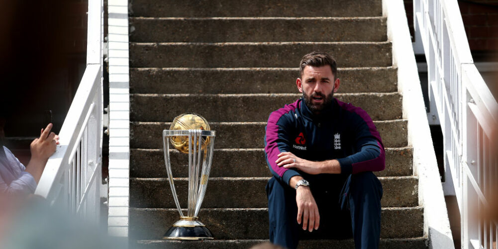 Liam Plunkett sits next to World Cup Trophy